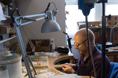Malcolm Morris working on the jewellery bench in his london workshop creating silver and gold designer jewellery